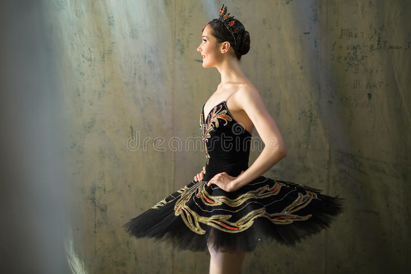 Ballerina standing backstage before going on stage. Prima ballerina standing backstage before going on stage for a solo program on the stage in a performance of stock photo