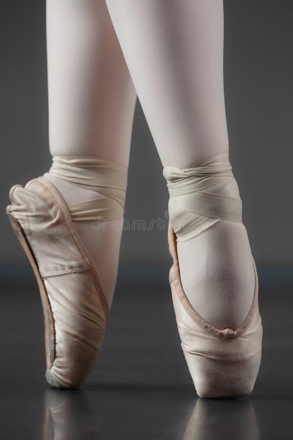 Ballerina standing en pointe in ballet slippers royalty free stock photo