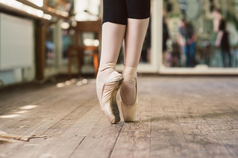 Ballerina standing on toes stock photography