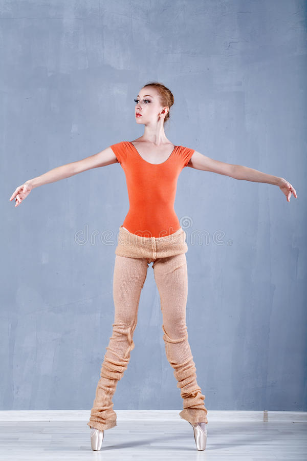 Ballerina warming up before rehearsal. Girl stands on tiptoe. Classical Ballet stock photos