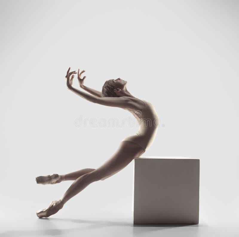 Ballerina. Young graceful female ballet dancer dancing at studio. Beauty of classic ballet. royalty free stock image