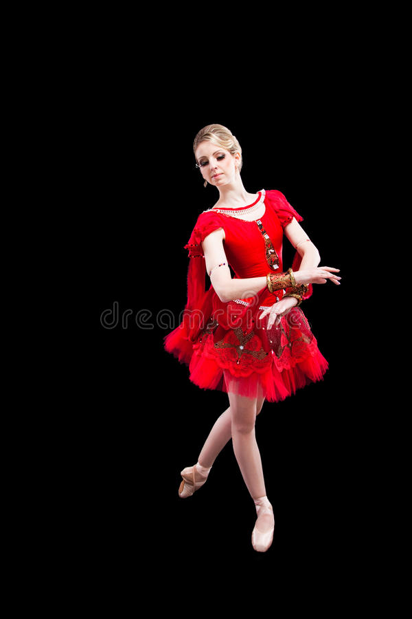 Ballerine dans le tutu rouge sur le noir d'isolement images libres de droits
