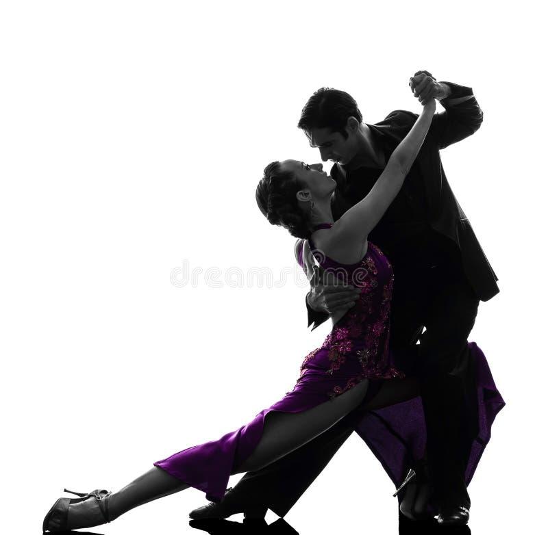 Ballerini della sala da ballo della donna dell'uomo delle coppie che tangoing siluetta fotografia stock