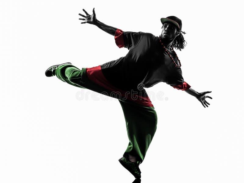 Ballerino acrobatico hip-hop della rottura che breakdancing la siluetta del giovane fotografia stock