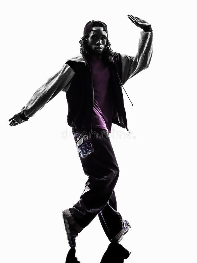 Ballerino acrobatico hip-hop della rottura che breakdancing la siluetta del giovane fotografia stock libera da diritti