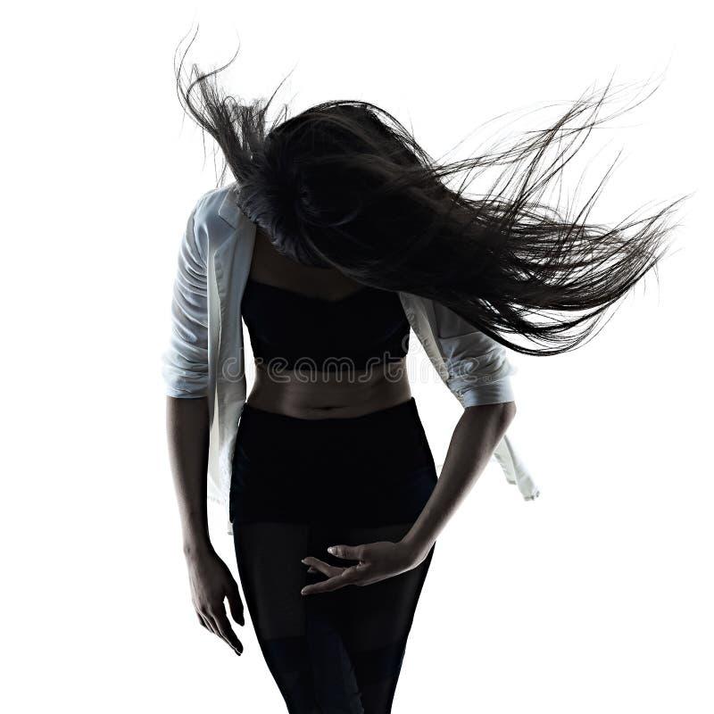 Ballerino di balletto moderno della giovane donna che balla l'ombra bianca isolata della siluetta del fondo immagini stock libere da diritti
