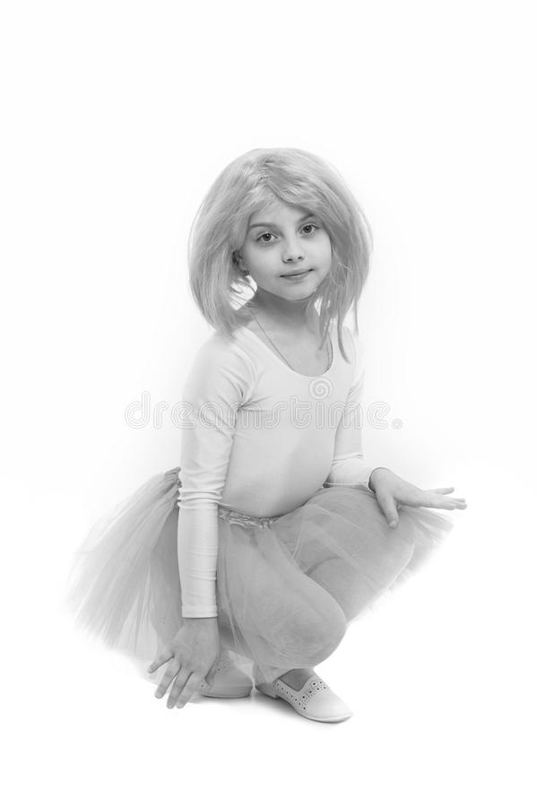 Ballet and art. Small girl t in pink skirt. Child in wig isolate stock photos