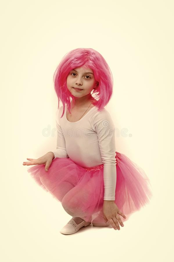 Ballet and art. Small girl t in pink skirt. Child in wig isolated on white background. beauty and fashion. Childhood and. Happiness stock photography