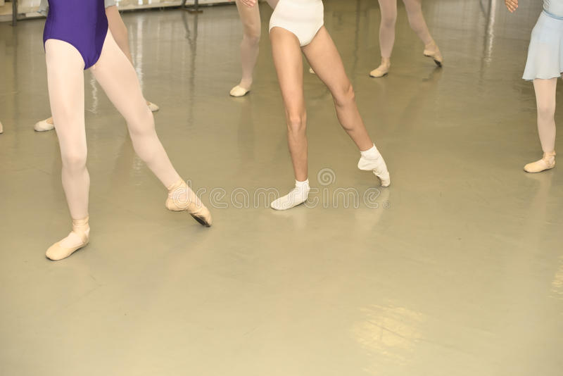 Ballet class. Young girls are in ballet position stock image
