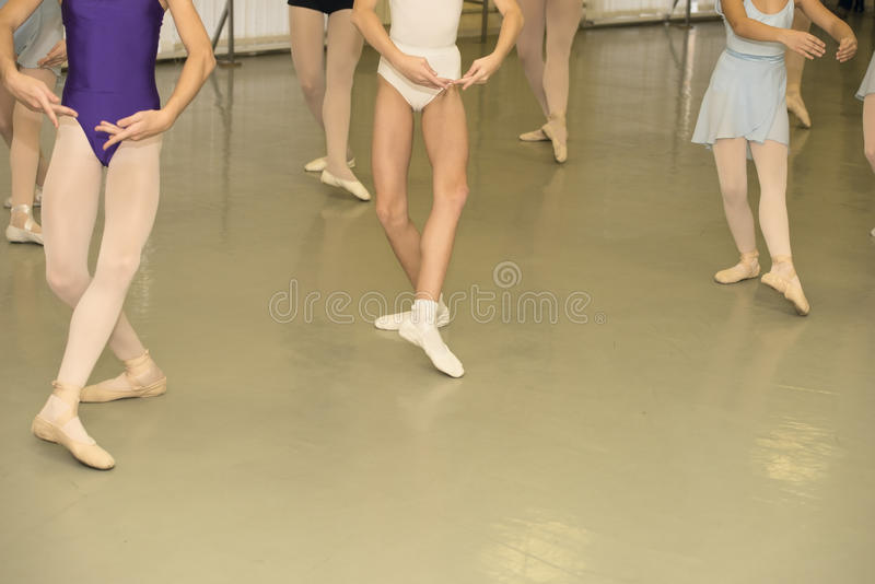 Ballet class. Young girls are in ballet position stock photography