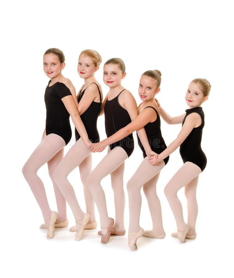 Ballet Dance Friends. Young Ballet Dancers Lineup in Class royalty free stock photo