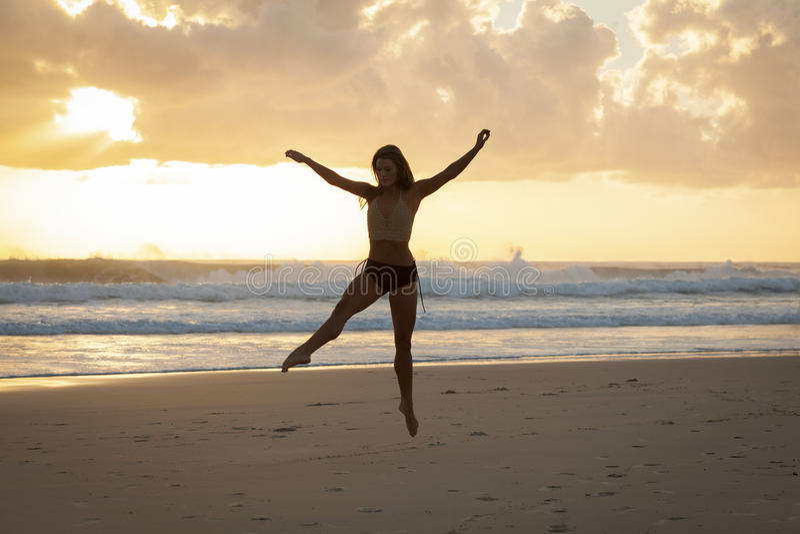 Ballet dancer on beach royalty free stock photo