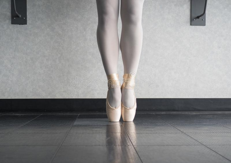 Ballet dancer En pointe in her dance shoes royalty free stock photography
