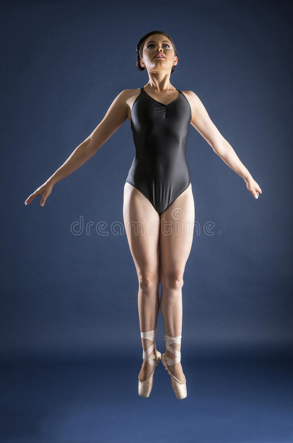 Ballet dancer and Gymnast. Gymnast and dancer performing actions. Acrobatic gymnastic royalty free stock photo