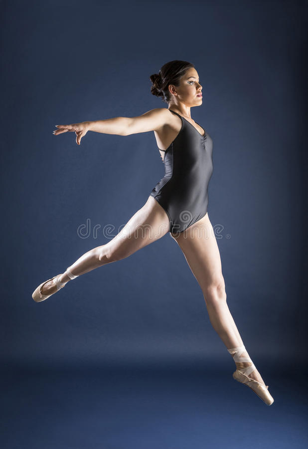 Ballet dancer and Gymnast. Gymnast and dancer performing actions. Acrobatic gymnastic royalty free stock image