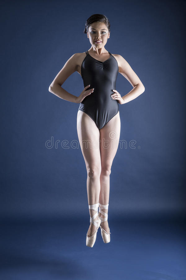 Ballet dancer and Gymnast. Gymnast and dancer performing actions. Acrobatic gymnastic stock image