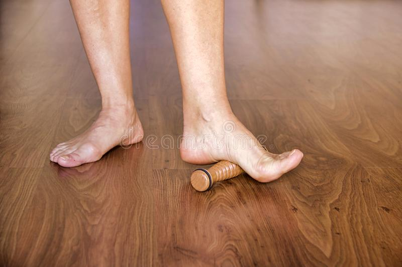 Ballet dancer massaging bare foot stock images