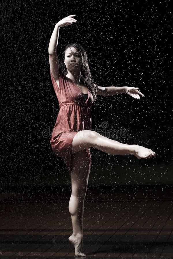 Ballet dancer in the rain royalty free stock photo