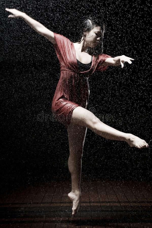 Ballet dancer in the rain royalty free stock photos