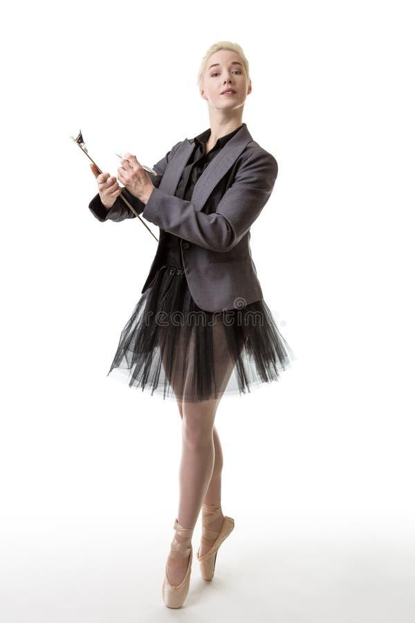 Ballet dancer ready to work. Ballerina model en pointe, holding a clipboard and pen stock photos