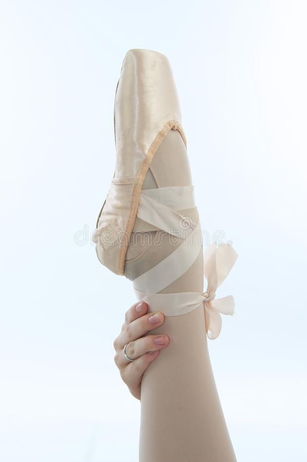 Ballet Dancer's Hand with Leg and Slipper royalty free stock photos