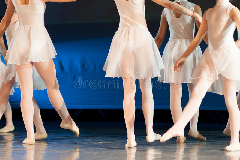Ballet dancers. Girls in white dresses during ballet performance stock photo