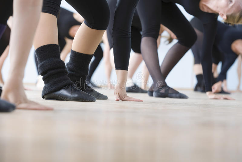 Ballet Dancers Practicing In Rehearsal Room. Low section of ballet dancers practicing in rehearsal room royalty free stock photos