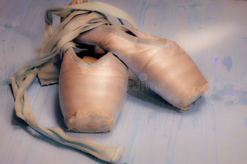 Ballet shoes. A pair of used ballet shoes stock photos