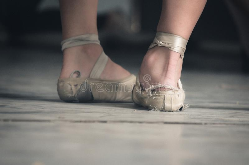 Ballet shoes of two Cuban dancers in tatters stock photography