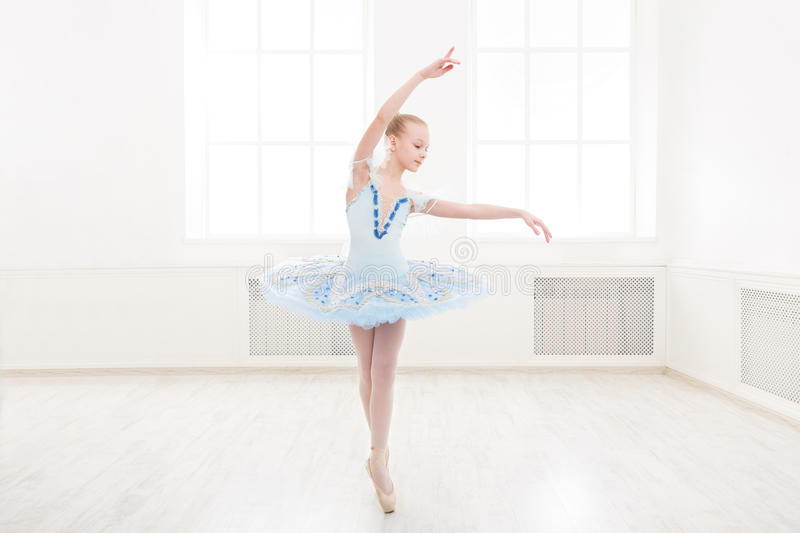 Ballet student exercising in ballet costume royalty free stock photography