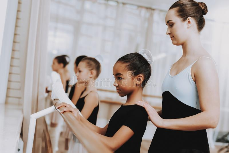Ballet Training of Group of Girls with Teacher. royalty free stock photography