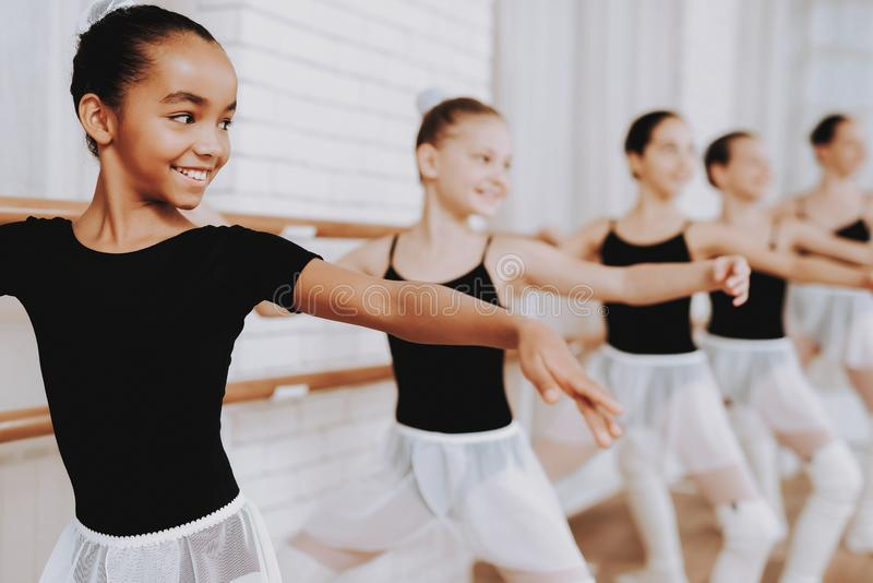Ballet Training of Group of Young Girls Indoors. royalty free stock images