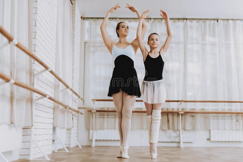 Ballet Training of Little Girl with Teacher Indoor royalty free stock images