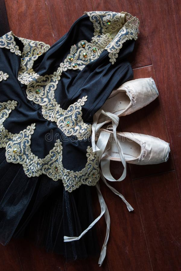Ballet tutu and pointe shoes in a rehearsal background. Old pointe shoes royalty free stock photo