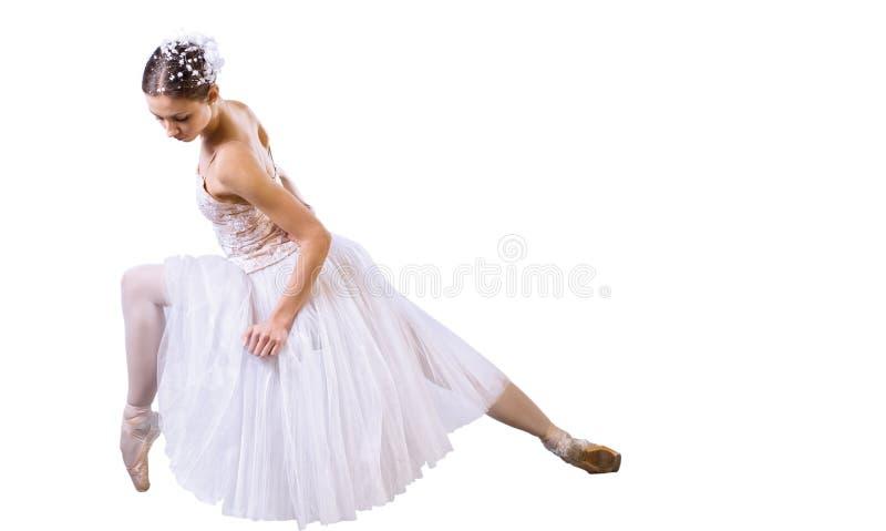 Balletttänzersitzen stockfotografie