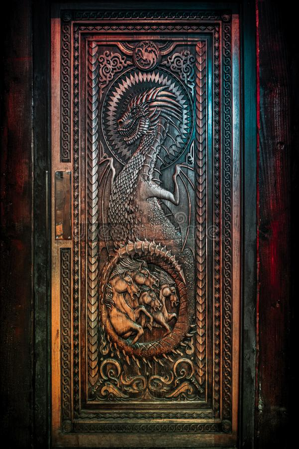 Free BALLINTOY HARBOUR, NORTHERN IRELAND, DECEMBER 20, 2018: Magnificent Carved Door With Dragons And Dothraki Horses, Made With Wood Stock Photo - 161834150