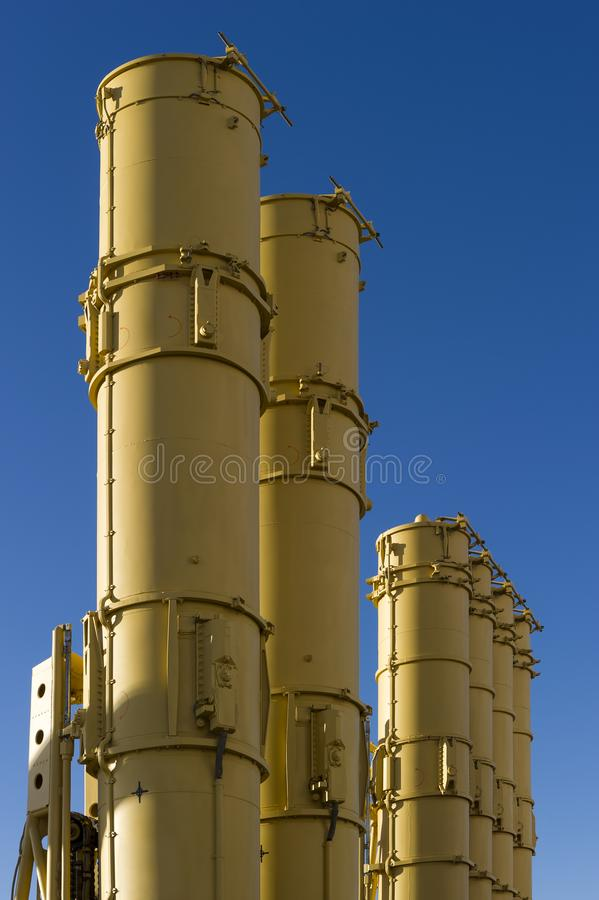 Ballistic missile launcher. Antiaircraft missile launcher, military ballistic rockets ready to attack, blue sky on background, modern army industry royalty free stock image