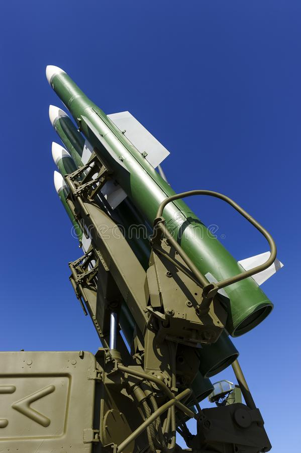 Ballistic missile launcher. With four cruise missiles on powerful mobile transportation with blue sky on background, antiaircraft forces, military industry stock photo