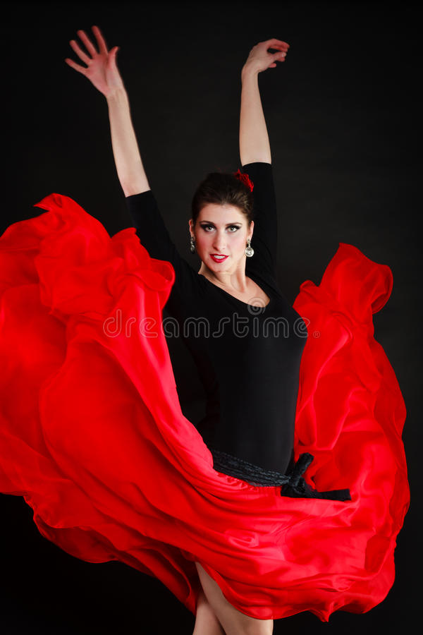 ballo Ragazza spagnola nel flamenco rosso di dancing della gonna fotografia stock libera da diritti