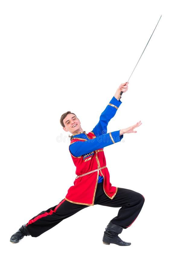Ballo russo del cossack Giovane ballerino che posa con la spada immagine stock libera da diritti