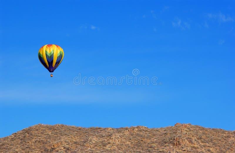 Ballon. A hot air ballon and blue sky royalty free stock photo