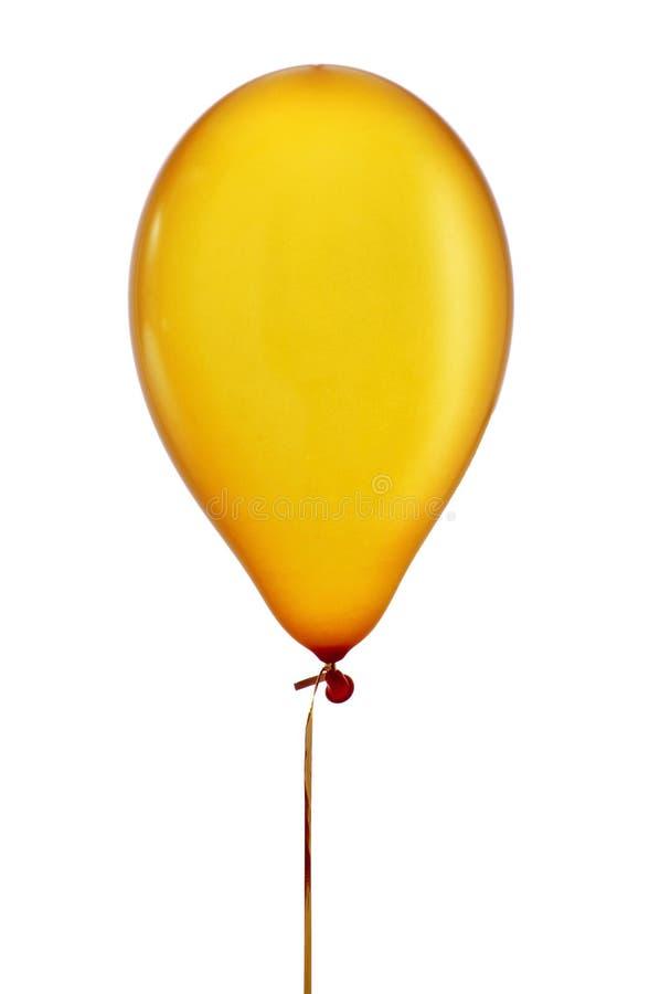 Ballon d'or gonflé dans une ficelle photographie stock libre de droits