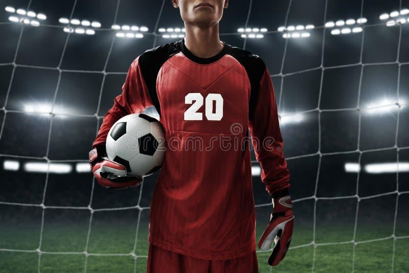 Ballon de football de prise de gardien de but du football image libre de droits