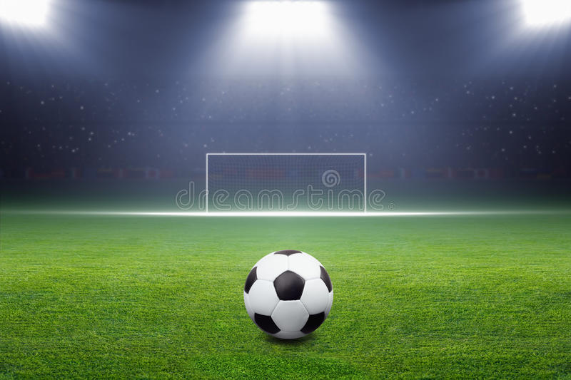 Ballon de football, but, projecteur photos stock