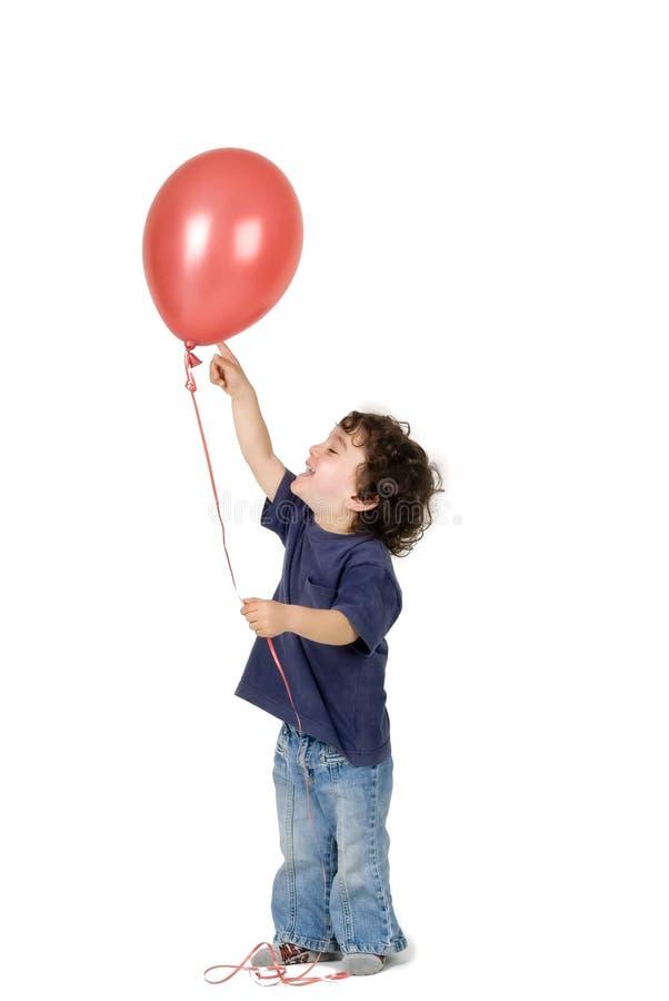 Ballon de rouge de petit garçon images stock