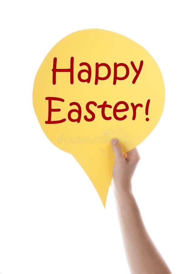 Ballon jaune de la parole avec Joyeuses Pâques images stock