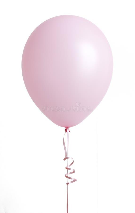 Ballon rose sur le blanc images libres de droits