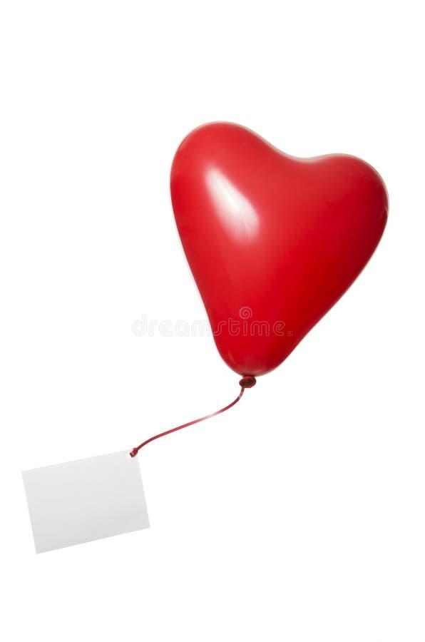 Ballon rouge de coeur avec la bande et la carte de voeux photos libres de droits