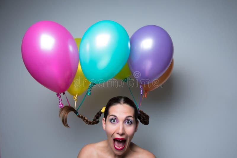 Ballone im Kopf lizenzfreie stockbilder