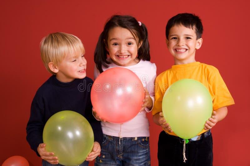 ballons χαμόγελο παιδιών στοκ φωτογραφία με δικαίωμα ελεύθερης χρήσης